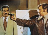 The Burglar, starring Omar Sharif (left) and Jean-Paul Belmondo (right), contains one of the best car chases ever.