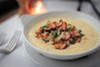The crab and grits is a luscious platter of ultra-creamy maize snarked up with garlic and spicy crab.