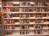 COURTESY OF DAN HESS - The discarding of books has left the Albany Library with half-empty shelves.