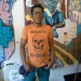 "The Grease Diner co-owner Jon Jon Cassagnol models their ""anti-Monsanto Bio-Terrorist"" t-shirt - COURTESY OF THE GREASE DINER"