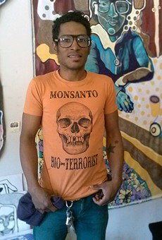 "The Grease Diner co-owner Jon Jon Cassagnol models their ""anti-Monsanto Bio-Terrorist"" t-shirt"