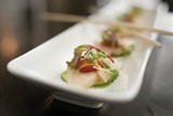 The hamachi crudo is paired with blood orange, Fresno pepper, Maui onion and cilantro. Photo by Chris Duffey