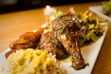 CHRIS DUFFEY - The jerk chicken spends three days in a dry rub and a marinade before being slow-roasted.
