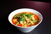 The <i>laksa mee</i> included strips of tender chicken, fried tofu puffs, and toothsome egg noodles all served in a reddish-orange coconut curry broth.