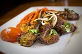 CHRIS DUFFEY - The lamb kebabs are tender and juicy, with a pleasant kick from dried-chile powder.