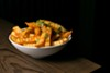 The <i>masala</i> fries stayed crispy, despite being doused in hot sauce.