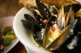 CHRIS DUFFEY - The mussels at The Cook and Her Farmer come in a garlicky beer broth.