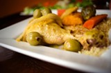 CHRIS DUFFEY - The tagine-style chicken is braised with green olives and preserved lemon.