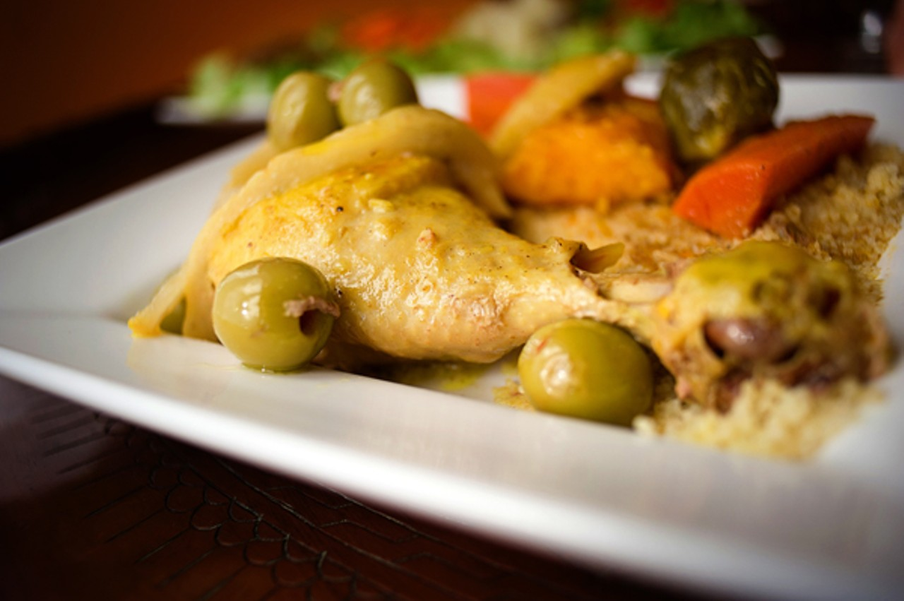 ... tagine-style chicken is braised with green olives and preserved lemon