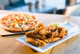 BERT JOHNSON - The wings at Plank are traditional and satisfyingly greasy.