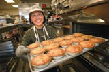 CHRIS DUFFEY - Theresia Gunawan and a fresh batch of pies.