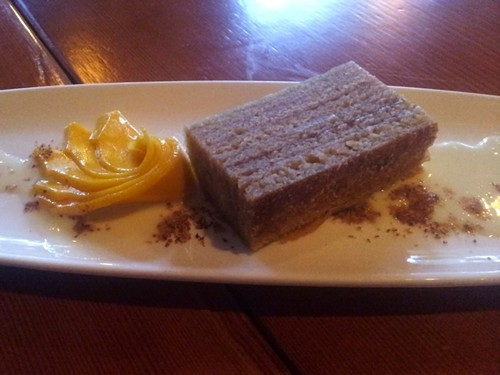 Thousand-layer cake, served with coconut condensed milk and slices of fresh mango.