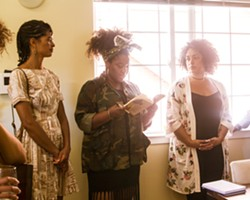 Carrie Y.T. Kholi (center) leads a community greeting. - PHOTO COURTESY OF JASMIN PORTER
