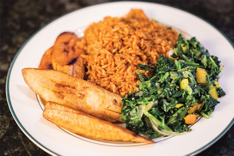 Jollof rice, plantains, and greens — a vegetarian feast. - PHOTO BY MELATI CITRAWIREJA