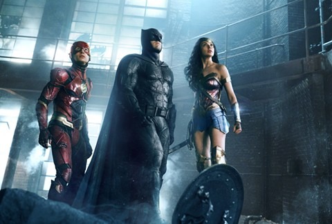 Ezra Miller, Ben Affleck, and Gal Gadot team up in Justice League.