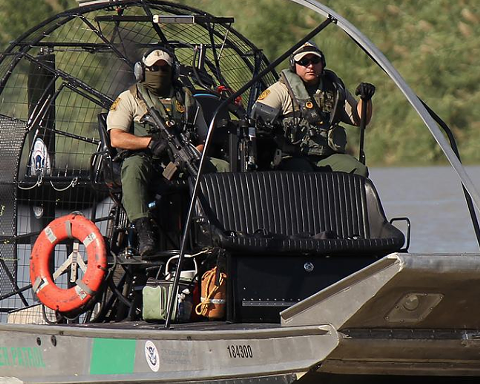 Border Patrol agents on a boat. A Safariland brand company supplied boat armor to the agency.