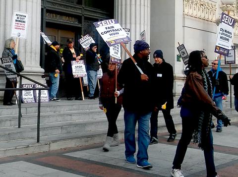 A picket outside Oakland City Hall Monday morning. - DARWIN BONDGRAHAM