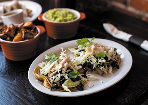 Kale, mushrooms, black beans, and slaw make for strong vegetarian tacos. - PHOTO BY MELATI CITRAWIREJA