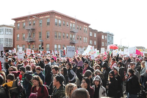 The Women's March drew 100,000 people to downtown Oakland. - PHOTO BY ANDRIA LO