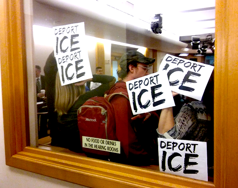 Activists at last week's Oakland public safety committee meeting demanding the city sever all ties to ICE.