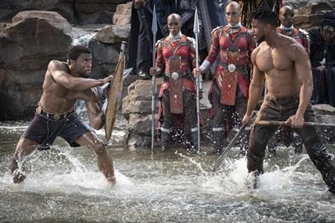 Chadwick Boseman (left) and Michael B. Jordan tangle in Black Panther.