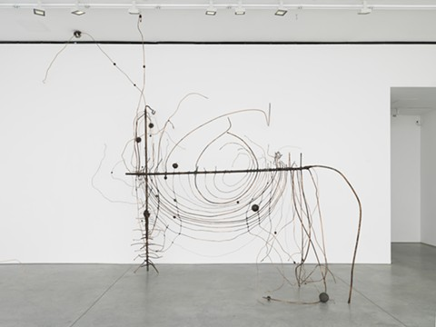 "Heikes' ""Couper l'oeil,"" a massive sculpture composed of copper, wax, aluminum foil, steel, steel slag, cast bronze, and iron, evokes a wire fence unraveling at the seams. - COURTESY OF BAMPFA"