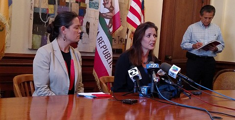 Libby Schaaf (center) is sticking by her decision to warn the public about pending ICE raids.