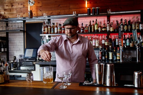 Christopher Parks mixes drinks at his recently renamed Bar 41. - PHOTO COURTESY OF BAR 41