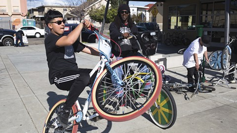Scraper bikes are integral to life for East Oakland kids. - PHOTO BY RICHARD LOMIBAO