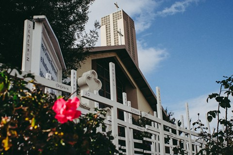 St. Columba Catholic Church in Oakland, where crosses represent homicide victims. - PHOTO BY CINQUE MUBARAK