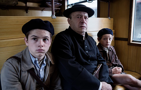 (left to right): Batyste Fleurial Palmieri, Etienne Chicot, and Dorian Le Clech on the train to Vichy in A Bag of Marbles.