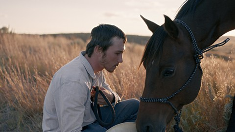 Brady Jandreau and friend in The Rider.