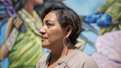 Etel Calles, a volunteer with the Immigrant Family Defense Fund, said she's motivated to help families facing deportation because of her own immigration experience. As a child, she came to the U.S. alone in order to flee the civil war in El Salvador. - PHOTO BY ROSA FURNEAUX