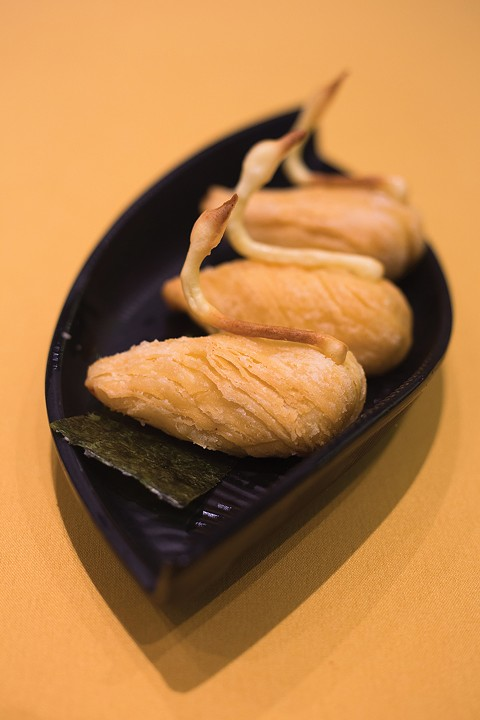 Durian fruit is baked into buttery, swan-shaped pastries. - PHOTO BY RICHARD LOMIBAO