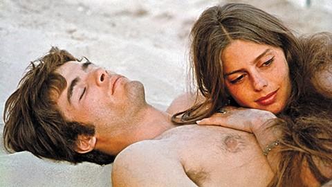 Mark Frechette and Daria Halprin stretch out on the sand in Michelangelo Antonioni'sZabriskie Point.