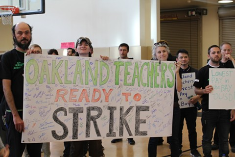 Oakland Education Association teachers' union members threaten to strike due to stalled negotiations at May 9, 2018 school board meeting. - PHOTO BY THERESA HARRINGTON FOR EDSOURCE