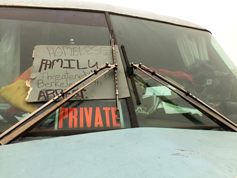 A protest sign in one of the RVs in the Hs Lordships restaurant parking lot at the Berkeley Marina.
