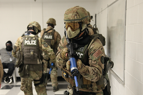 """Berkeley police officers took part in an """"extremist manhunt"""" and """"community justice center takeover"""" SWAT exercise at the 2012 Urban Shield exercise. - SAN LEANDRO PRIVACY"""