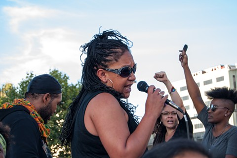 Oakland mayoral candidate Cat Brooks leads a call-and-response chant. - DREW COSTLEY