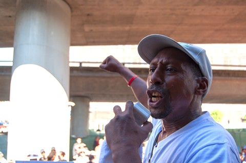 Daryle Allums of the Stop Killing Our Kids Movement speaks at the vigil for Nia Wilson. - DREW COSTLEY