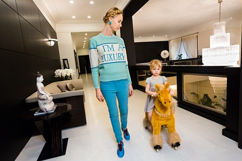 Ilona at home with her four-year-old daughter, Michelle. - PHOTO BY LAUREN GREENFIELD (COURTESY OF AMAZON STUDIOS)
