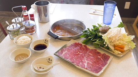 Shabu House's tables are built for shabu shabu. - PHOTO BY LANCE YAMAMOTO