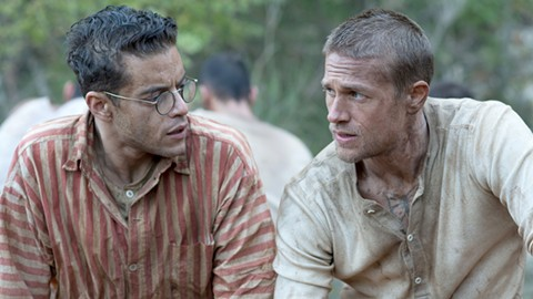 Rami Malek (left) and Charlie Hunnam plot their escape in Papillon.