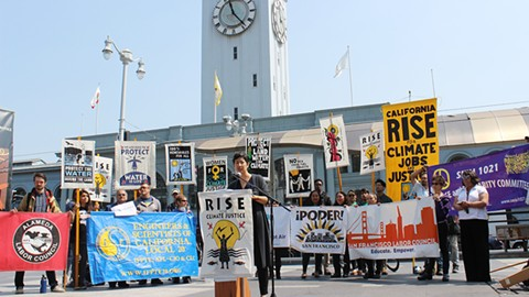 Miya Yoshitani of APEN speaks at a press conference for the Sept. 8 climate march. - PHOTO BY EMILY JOVAIS