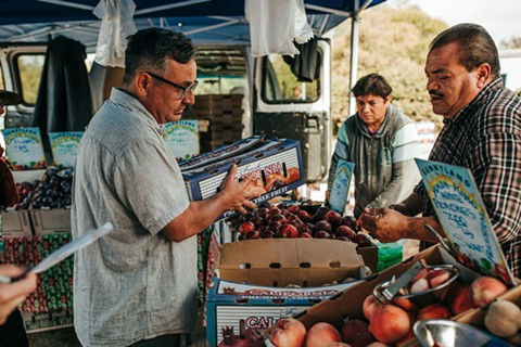 Chef Ed Vigil shops for produce and more at the Marin Farmers' Market. - PHOTO BY ANNAMAE PHOTO
