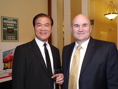 Harry Hu, left, with Assistant Oakland Police Chief David Dowing in 2015. - FILE PHOTO