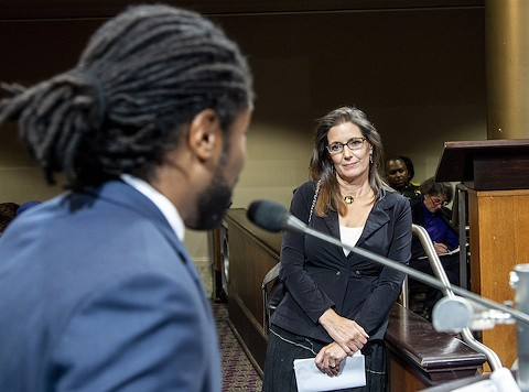 Oakland Mayor Libby Schaaf listens to Henry Gage during a police commission meeting last night. - APRIL MARTIN