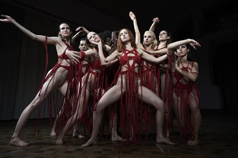 Dakota Johnson (center) and her dance company perform.
