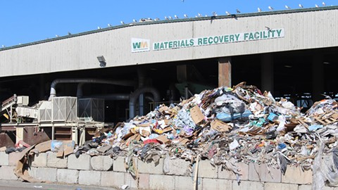 The Davis Street Transfer Station processes 7 million pounds of recycling daily. - PHOTO BY NISHA BALARAM