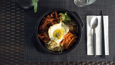 The spicy pork bibimbap came with an exceptionally generous portion of lean meat that was spicy without being too salty. - PHOTO BY LANCE YAMAMOTO